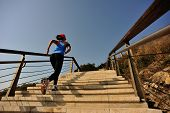 picture of stepping stones  - healthy lifestyle sports woman running up on stone stairs sunrise seaside - JPG