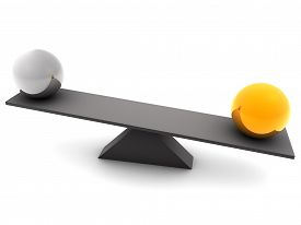 picture of seesaw  - Unbalanced concept depicted with the help of seesaw having a golden and a silver ball - JPG