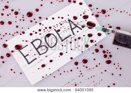 Ebola Concept With Blood Filled Syringe