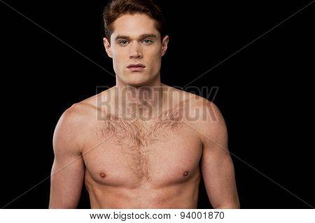 Muscular Man Posing Over Black