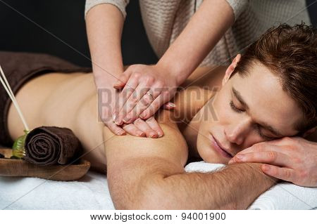 Man Receiving Relax Treatment At Spa