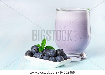 Milk cocktail with ripe blueberries.
