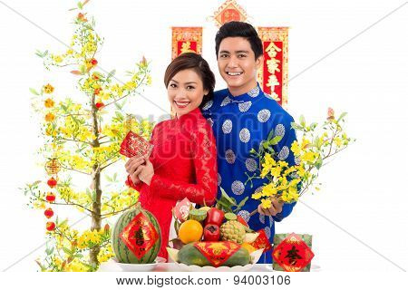 Vietnamese Couple At The Holiday Table