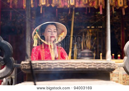 Praying Vietnamese Woman
