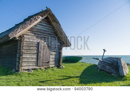 Rural Fisherman Utility House And Boats At Sea Coast
