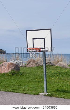 Basketball Hoop Near Sea Coast