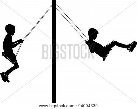 Boys Swinging On A Swing