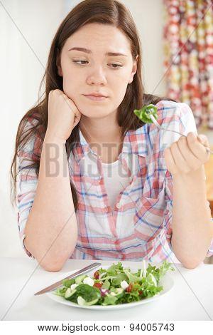 Teenage Girl On Diet Eating Plate Of Salad