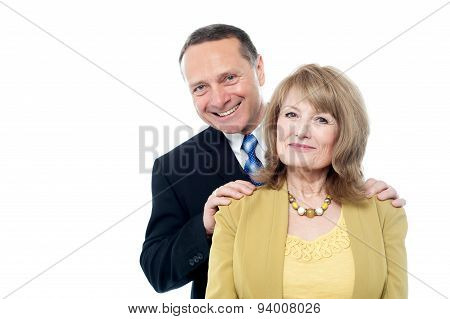 Elderly Couple Smiling To The Camera