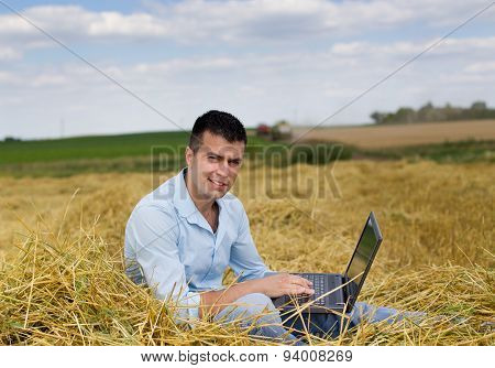 Man With Laptop On Haystack
