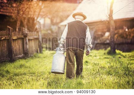 Farmer with milk kettle