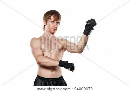 The Fighter In Mixed Martial Fighting Gloves