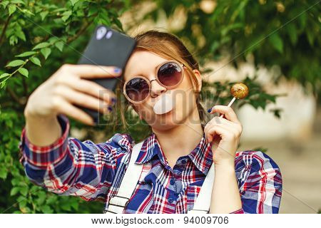 Selfie Hipster Girl With Lollipop And Chewing Gum