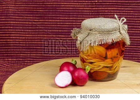 Jar Of Pickled Cheese In Oil With Radishes