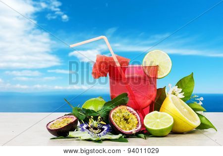 Summer Fruits Cocktail Against Relaxing Sky Background