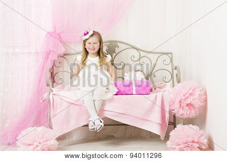 Kid Little Girl Portrait, Smiling Child Four Years With Pink Present Gift Box In Decorated Children