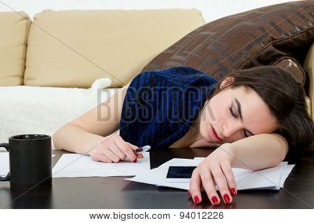 Student Tired And Sleeping In Her Living Room Over The Notes.