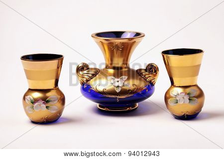 Empty Blue And Gold Ornate Glass Vase And Small Wineglass