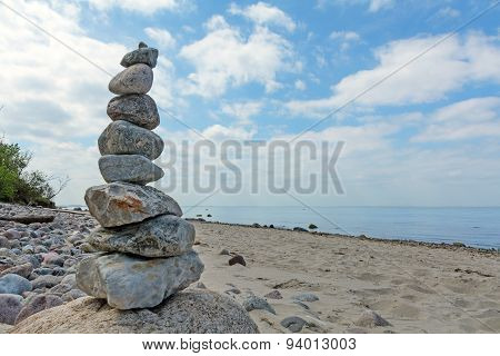 Balanced Stones Stacked To A Tower On The Beach Of The Baltic Sea