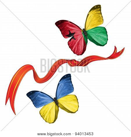 Two butterflies with symbols of Ukraine and Guinea-Bissau