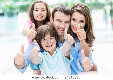 Family showing thumbs up