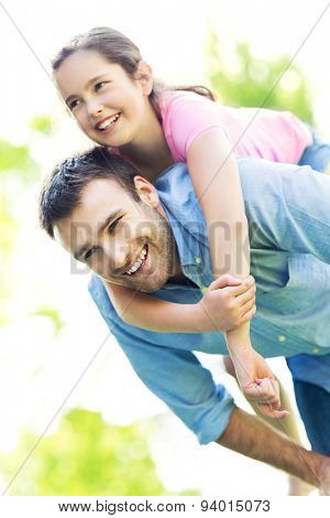 Father giving his daughter a piggyback