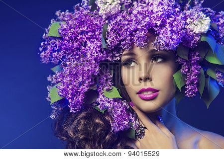 Woman Lilac Flower Fashion Hairstyle. Model Beauty Portrait, Girl Face Makeup With Purple Flowers