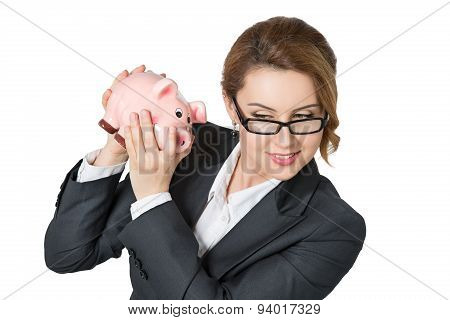 Businesswoman Shaking Piggybank Checking Money