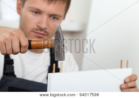 Man Assembling Furniture