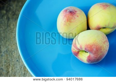 Juicy Peaches  In Ceramic Plate On Wooden Background