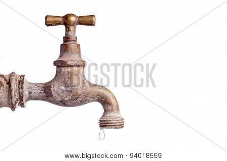 Old And Used Vintage Faucet With Water Drop