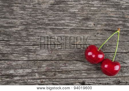 Dual Ripe Cherry On A Vintage Wooden Background