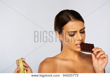 portrait of a brunette young woman with chocolate