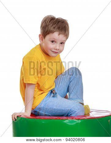 Fair-haired little boy in a yellow t-shirt