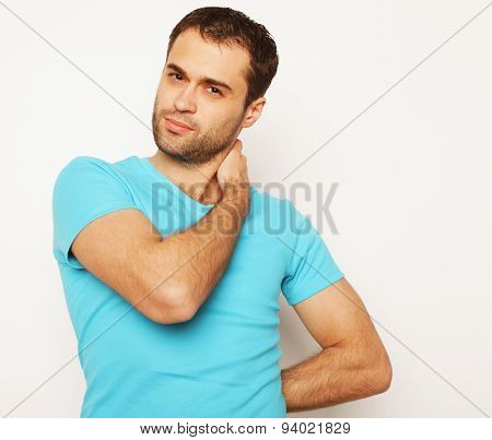life style  and people concept: handsome man in blue shirt, studio shot isolated on white background.