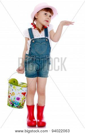 girl in a short denim overalls holding