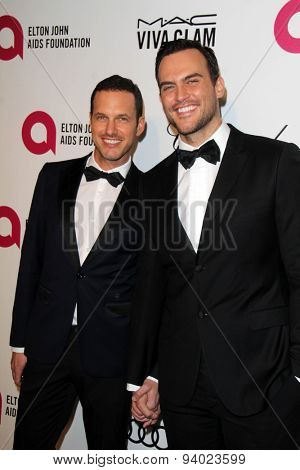LOS ANGELES - MAR 3:  Cheyenne Jackson, Jason Landau at the Elton John AIDS Foundation's Oscar Viewing Party at the West Hollywood Park on March 3, 2014 in West Hollywood, CA