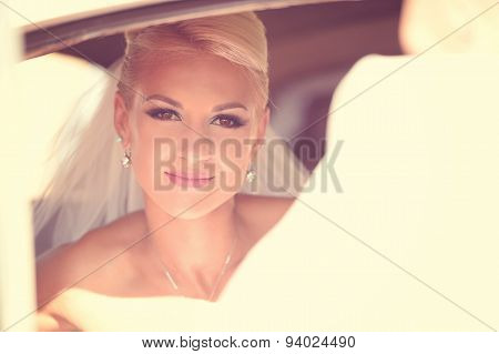 Beautiful Bride Waiting In The Car