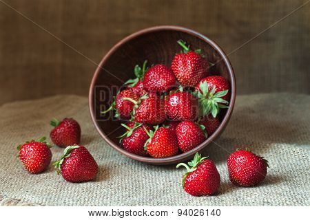 Strawberries fresh organic healthy nutrition vegetarian summer food in rustic clay dish on vintage k