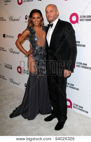 LOS ANGELES - MAR 3:  Melanie Brown, Stephen Belafonte at the Elton John AIDS Foundation's Oscar Viewing Party at the West Hollywood Park on March 3, 2014 in West Hollywood, CA