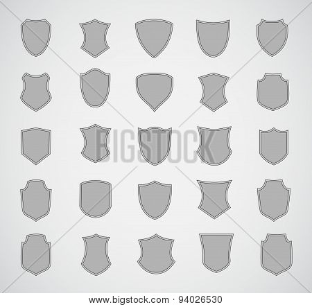 Grey silhouette shield design set of various shapes