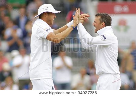 MANCHESTER, ENGLAND - August 04 2013: Stuart Broad and Graeme Swann celebrate the wicket of Usman Khawaja during day four of  the Investec Ashes 4th test match at Old Trafford Cricket Ground
