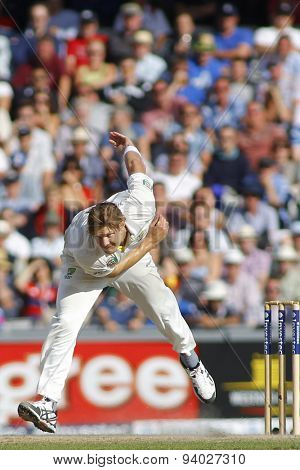 MANCHESTER, ENGLAND - August 03 2013: Shane Watson bowling during day three of  the Investec Ashes 3rd test match at Old Trafford Cricket Ground, on August 03, 2013 in London, England.