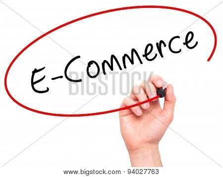 Man Hand writing E-Commerce with black marker on visual screen.