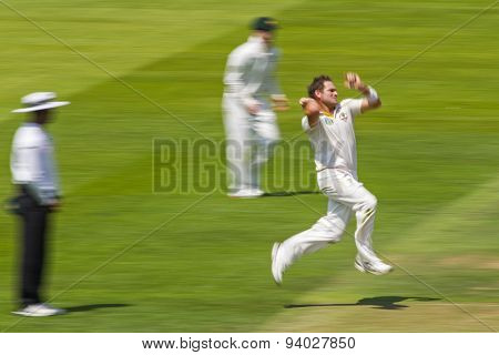 LONDON, ENGLAND - July 18 2013: Ryan Harris bowling on day one of the Investec Ashes 2nd test match, at Lords Cricket Ground on July 18, 2013 in London, England.