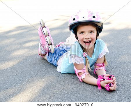 Happy Little Girl In Pink Roller Skates
