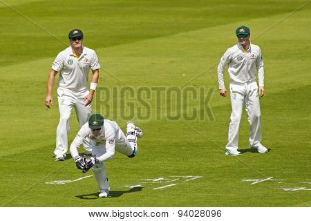 LONDON, ENGLAND - July 18 2013: Brad Haddin catches the ball as Shane Watson and Michael Clarke watch on day one of the Investec Ashes 2nd test match, at Lords Cricket Ground on July 18, 2013