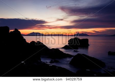 Rock silhouettes and vivid sunset