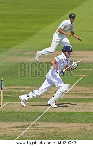 LONDON, ENGLAND - July 18 2013: Alastair Cook sets off for a single on day one of the Investec Ashes 2nd test match, at Lords Cricket Ground on July 18, 2013 in London, England.
