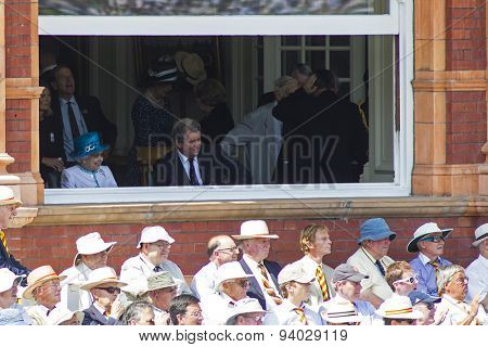 LONDON, ENGLAND - July 18 2013: Her Majesty Queen Elizabeth the 2nd watches on day one of the Investec Ashes 2nd test match, at Lords Cricket Ground on July 18, 2013 in London, England.